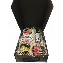 Cesta pequeña con pimentón, aceite, miel, jamón curado y lata aceite, ajo y tomate para empresas
