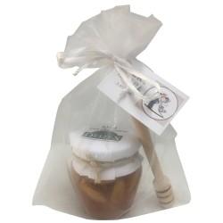 Tarro de miel con almendras y palito catador para empresas